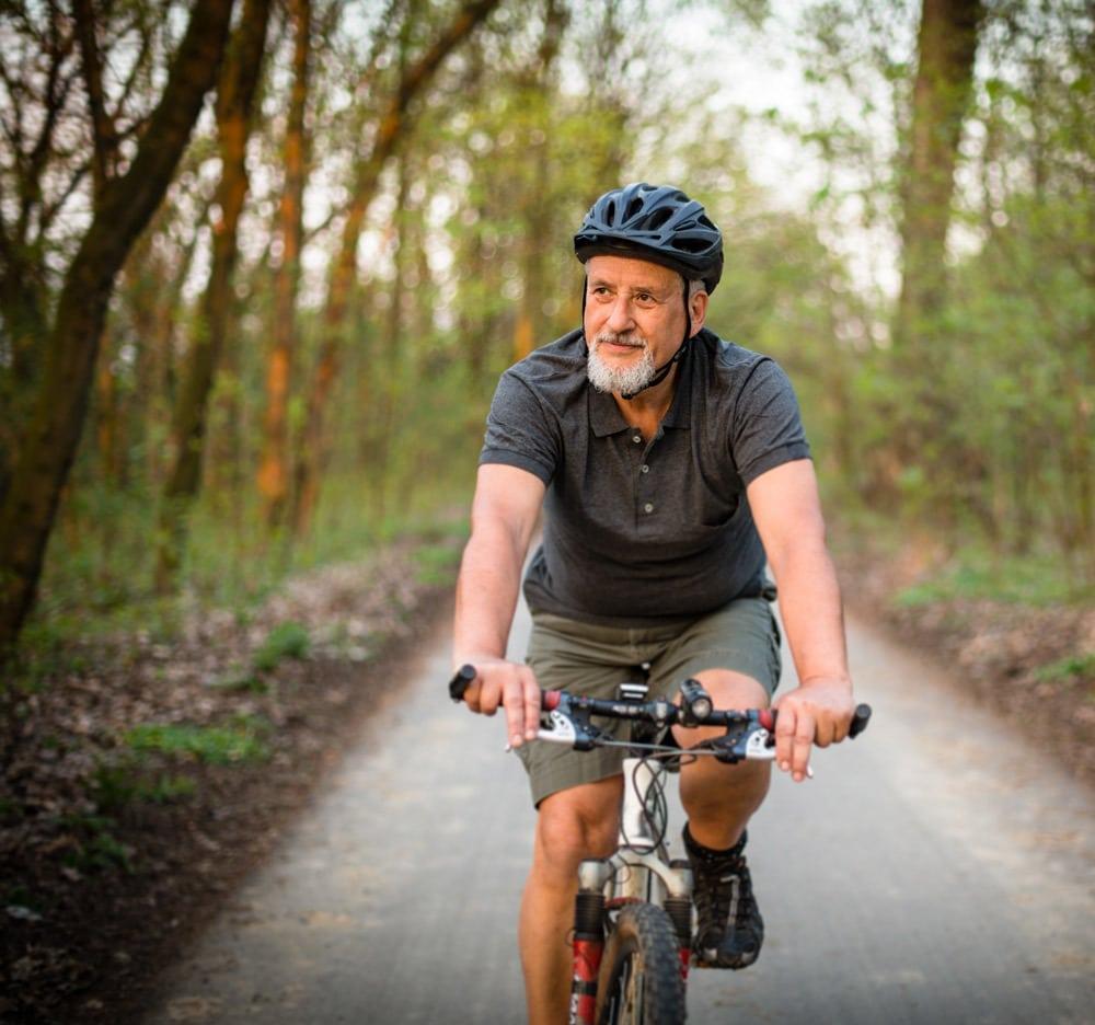 old man enjoying bike
